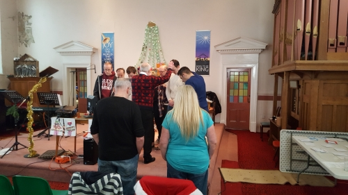 The 'old' Elders and Deacons pray for the new ones