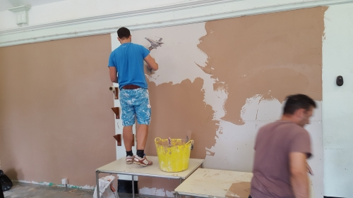 Adam and Wayne show off their plastering skills