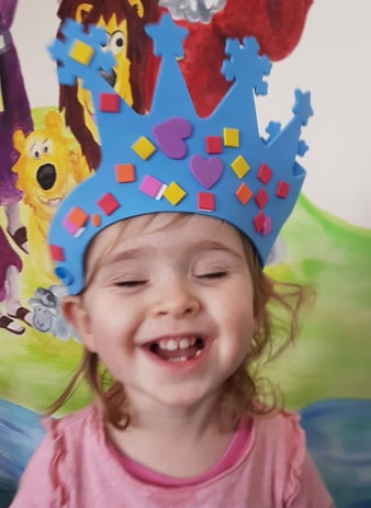 Caitlin loves the crown she made at Saplings Baby and Toddler