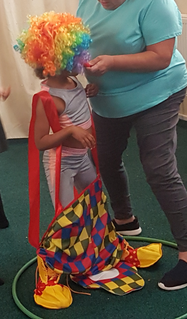 Clown dress up relay race