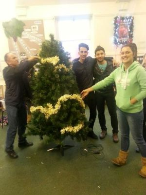 Ali, Farz, Habib and Stef decorate the tree in the green room